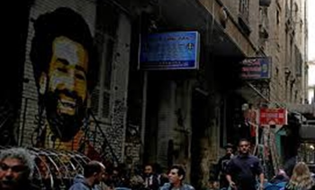 cover photo: A picture of Liverpool's Egyptian midfielder Mohamed Salah is seen as people sit outside a coffee shop in Cairo, Egypt December 24, 2017. REUTERS/Amr Abdallah Dalsh