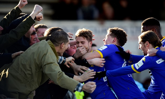 Soccer Football - FA Cup Third Round - Newport County AFC vs Leeds United - Rodney Parade, Newport, Britain - January 7, 2018 Leeds United's Gaetano Berardi celebrates scoring their first goal with fans REUTERS/Rebecca Naden