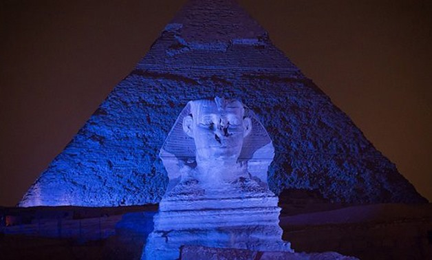 The Pyramids of Giza lit in blue for World Autism Awareness Day, April 2, 2017 - Youm7