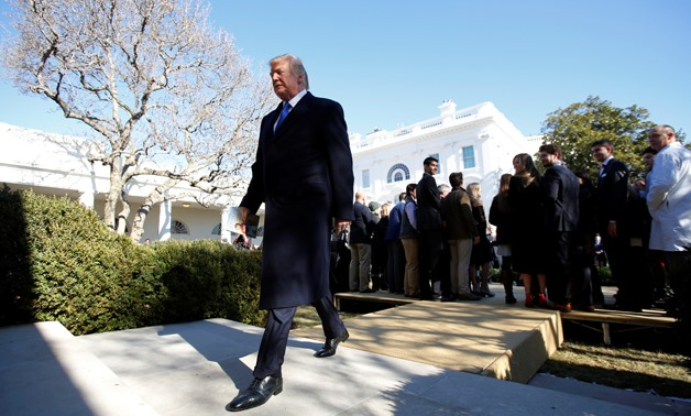 U.S. President Donald Trump leaves after addressing the annual March for Life rally, taking place on the National Mall, from the White House Rose Garden in Washington, U.S., January 19, 2018. REUTERS/Carlos Barria