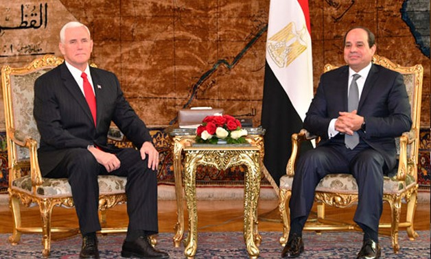 US Vice President Mike Pence (L) shakes hands with Egyptian President Abdel Fatah Al-Sisi (R) - File photo