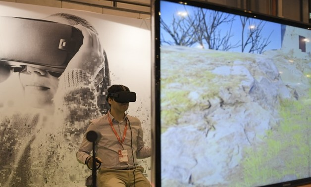 A man uses virtual reality glasses during the International Tourism Fair (FITUR) in Madrid. PHOTO: GABRIEL BOUYS / AFP