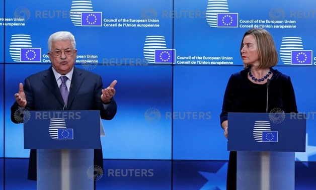 Palestinian President Mahmoud Abbas and European High Representative for Foreign Affairs Federica Mogherini give a press statement before a meeting with European Union foreign ministers in Brussels, Belgium, January 22, 2018. REUTERS/Yves Herman