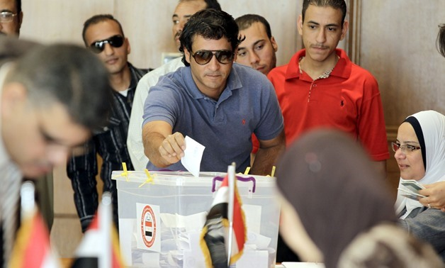 File- Egyptians living in Jordan cast their ballot in the early voting for the presidential election on May 26-27, at the Egyptian embassy in Amman, on May 15, 2014 - AFP
