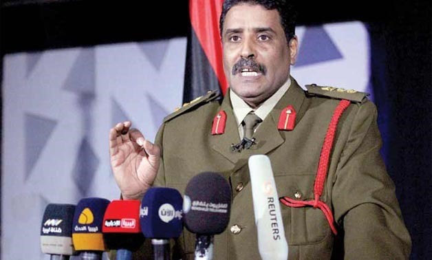 Libyan Army spokesman, Ahmed al-Mesmari speaks during a news conference in the coastal city of Benghazi - AFP