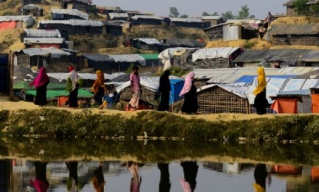 AFP/File / by Richard Sargent, with Annie BANERJI in Cox's Bazar | Rohingya refugees pictured in November at Balukhali refugee camp in Bangladesh