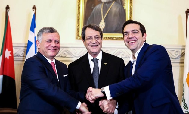 Cypriot President Nicos Anastasiades (C), Greek Prime Minister Alexis Tsipras (R) and Jordan's King Abdullah shake hands during a meeting at the Presidential Palace in Nicosia, Cyprus January 16, 2018. REUTERS/Iakovos Hatzistavrou/Pool