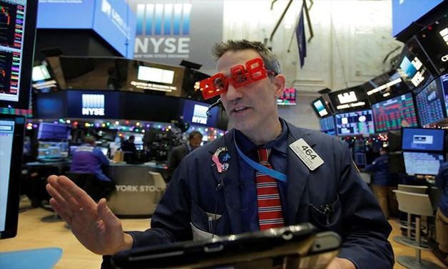 Trader Gregory Rowe works on the trading floor as the final day of trading for the year draws to a close with the Dow Jones Industrial Average setting a record high close for a trading year at the New York Stock Exchange (NYSE) in Manhattan, New York, U.S