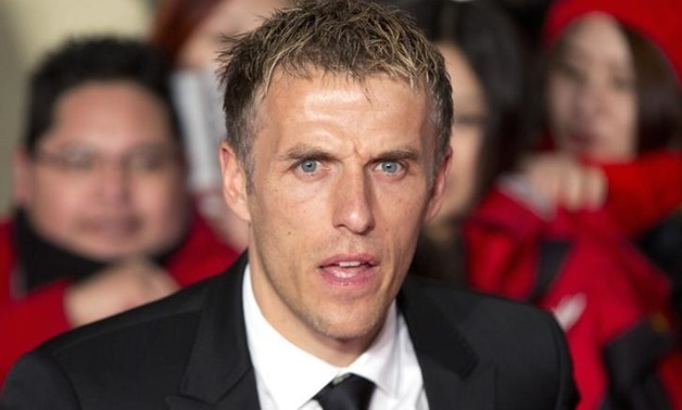 "Soccer player Phil Neville attends the world premiere of the film ""The Class of 92"" in London December 1, 2013 - REUTERS/Neil Hall"