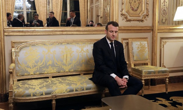 French President Emmanuel Macron reacts with Argentina's President Mauricio Macri (not pictured) during a meeting at the Elysee Palace in Paris, France, January 26, 2018. REUTERS/Ludovic Marin/Pool