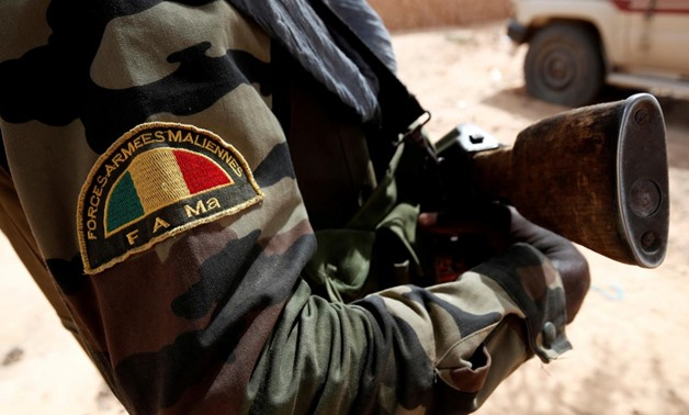 FILE PHOTO: A Malian Armed Forces patch worn by a soldier is pictured during the regional anti-insurgent Operation Barkhane in Tin Hama, Mali, October 19, 2017. REUTERS/Benoit Tessier/File Photo