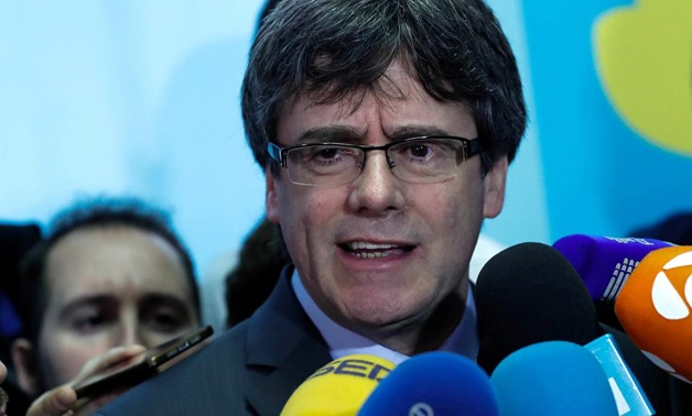 Former Catalan president Carles Puigdemont addresses the media after a meeting with Roger Torrent, speaker of Catalan Parliament, in Brussels, Belgium, January 24, 2018. REUTERS/Yves Herman
