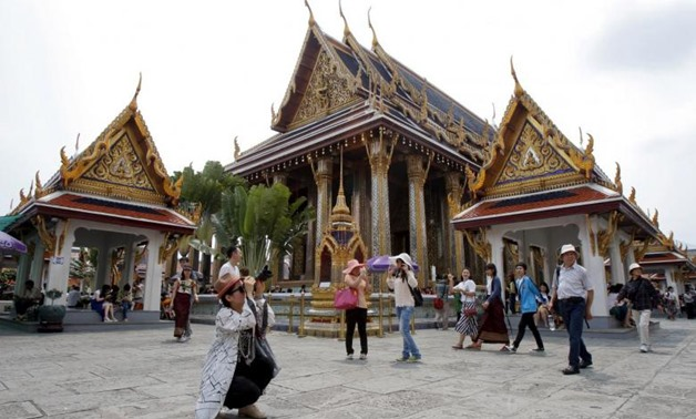 Chinese tourists visit Wat Phra Kaeo (Emerald Buddha Temple) in Bangkok March 23, 2015.