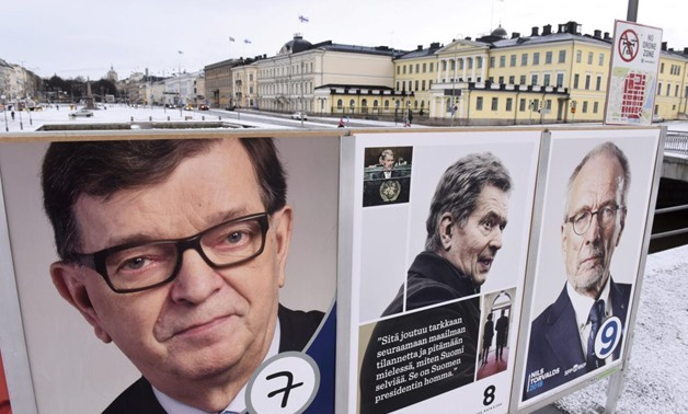 The campaign posters of the Finnish presidential candidates are seen in front of the presidential palace in Helsinki, Finland January 28, 2018 - Lehtikuva/Heikki Saukkomaa/via REUTERS