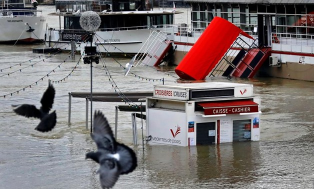 A ticket booth for sightseeing boats is partly submerged by the River Seine after days of almost non-stop rain caused flooding in the country, in Paris, France January 27, 2018 - REUTERS/Mal Langsdon