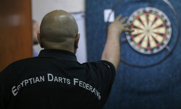 FILE - A sportsman playing Darts - Egypt Today