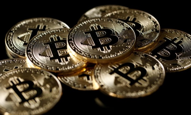 FILE PHOTO: A collection of Bitcoin (virtual currency) tokens are displayed in this picture illustration taken December 8, 2017. REUTERS/Benoit Tessier/Illustration/File Photo