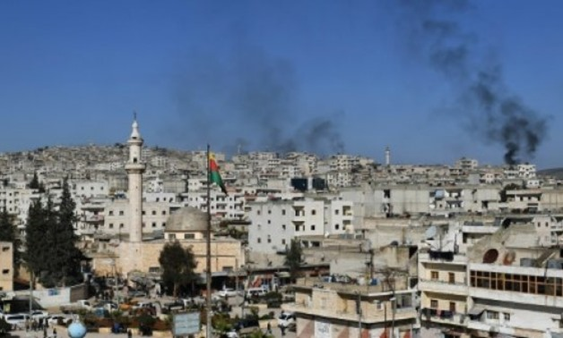 A picture taken on January 28, 2018, in the city of Afrin shows smoke billowing from surrounding areas during the Turkish military operation against the Kurdish enclave - AFP