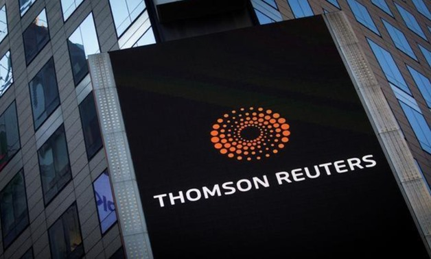 FILE PHOTO: The Thomson Reuters logo is seen on the company building in Times Square, New York October 29, 2013. REUTERS/Carlo Allegri/File Photo