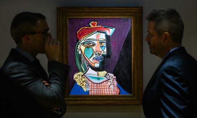 "Picasso's ""Femme au beret et a la robe quadrillee (Marie-Therese Walter)"" will go under the hammer on February 28 after displays in Hong Kong, Taipei, New York and London"