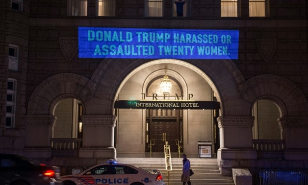 The latest projection by artist Robin Bell on the Trump International Hotel in Washington was timed to coincide with the president's State of the Union address