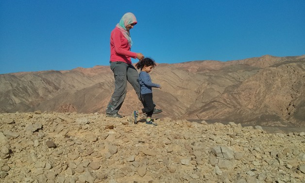 Taking a walk with Nour on top of a mountain in June 2017