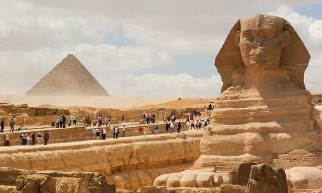 Tourists visit Giza Pyramids and Sphinx