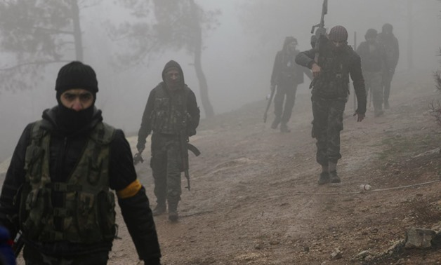 FILE PHOTO: Turkish-backed Free Syrian Army fighters are seen near Mount Barsaya, northeast of Afrin, Syria January 23, 2018 - REUTERS/Khalil Ashawi/File Photo