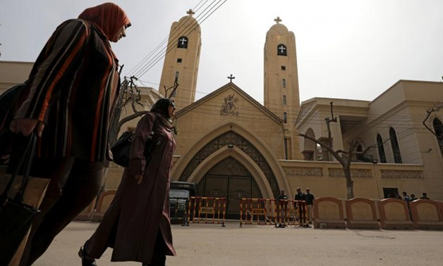 Women pass by the Coptic church that was bombed on Sunday in Tanta, Egypt, April 10, 2017- Reuters/Mohamed Abd El Ghany