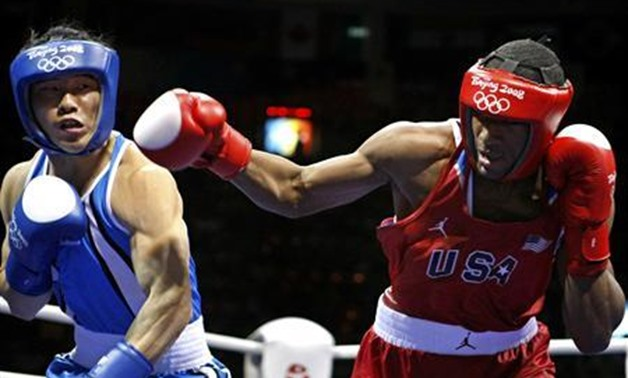 Kim Jungjoo (L) of Korea fights Demetrius Andrade of the U.S. during the men's welterweight (69kg) quarter-final boxing match at the Beijing 2008 Olympic Games August 17, 2008. REUTERS/Lee Jae-Won