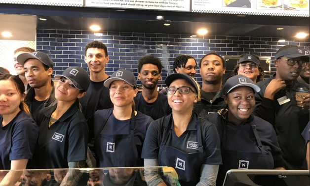 Newly hired employees take a break from training to pose for a group photo at the chain's soon-to-open 54th outlet in Oakland, California ,U.S., January 24, 2018. REUTERS/Ann Saphir
