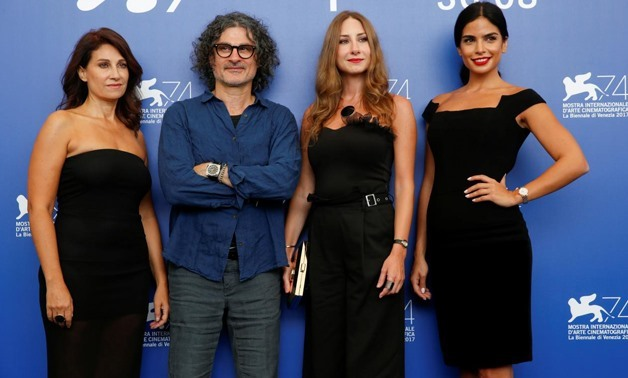 ": Director Ziad Doueiri (2nd L) poses with actors Rita Hayek (R), Christine Choueiri (L) and Diamand Bou Abboud from the movie ""The insult"" - Reuters"
