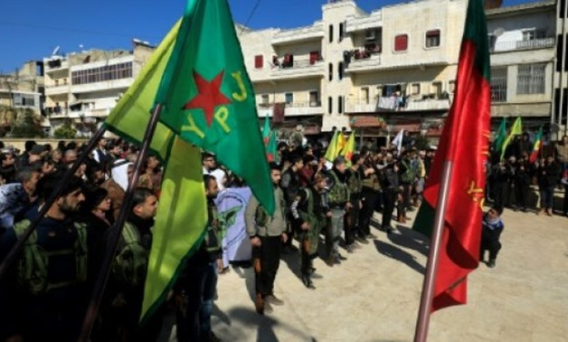 Syrian-Kurds attend an impromptu parade in Afrin as civilians enlist to fight an assault by Turkish troops and allied rebels on the Kurdish People's Protection Units (YPG) in Syria's border region on January 28, 2018 - AFP