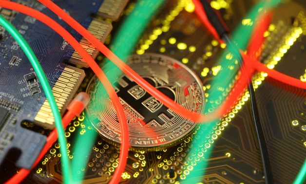 Representation of the Bitcoin virtual currency standing on the PC motherboard is seen - Reuters