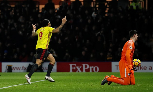 Soccer Football - Premier League - Watford vs Chelsea - Vicarage Road, Watford, Britain - February 5, 2018 Watford's Troy Deeney celebrates scoring their first goal as Chelsea's Thibaut Courtois looks dejected REUTERS/David Klein