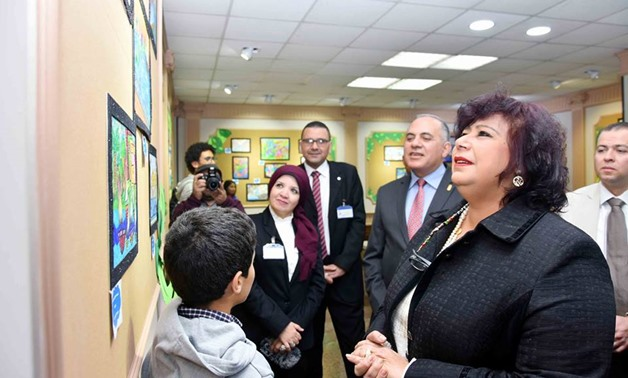 Minister of Culture Inas Abdel-Dayem looks at children's art work Feb. 5, 2018 - Photo courtesy of Cairo Opera House