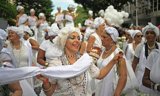 "Revellers perform during a ""bloco"" or informal street party in the run up to Rio's carnival -- but organizers are struggling to pay the bills for the events"