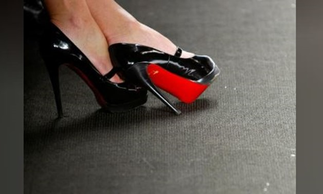 FILE PHOTO: A woman wearing a pair of Christian Louboutin shoes during Fashion Week in New York February 12, 2010. REUTERS/Carlo Allegri