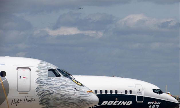 FILE PHOTO: A Boeing 737 MAX and an Embraer E190-E2 are seen on the static display, before the opening of the 52nd Paris Air Show at Le Bourget airport near Paris, France, June 16, 2017. REUTERS/Pascal Rossignol/File Photo
