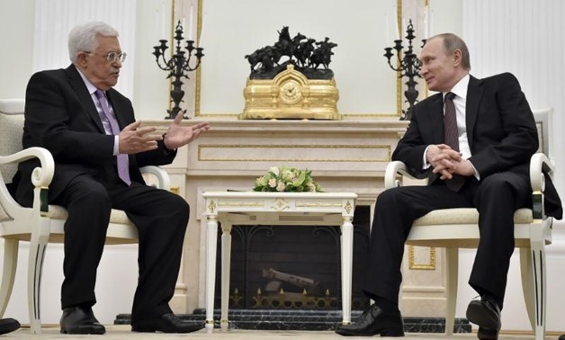 FILE PHOTO - Russian President Vladimir Putin (R) meets with Palestinian President Mahmoud Abbas at the Kremlin in Moscow, Russia, April 18, 2016. REUTERS/Alexander Nemenov/Pool