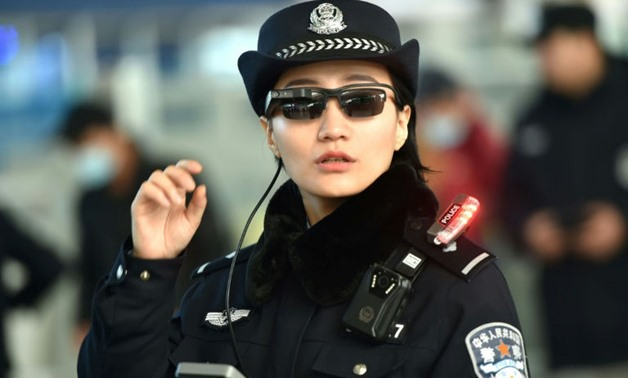 A Chinese police officer wears a pair of smartglasses with a facial recognition system at Zhengzhou East Railway Station in Zhengzhou in China's central Henan province - Photo AFP