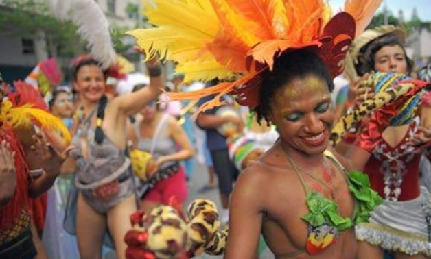 "RIO DE JAMEIRO, Brail — Revellers take part in a ""bloco"" or street party in the run up to Rio's carnival, in Rio de Janeiro, Brazil on February 4, 2018 - AFP"