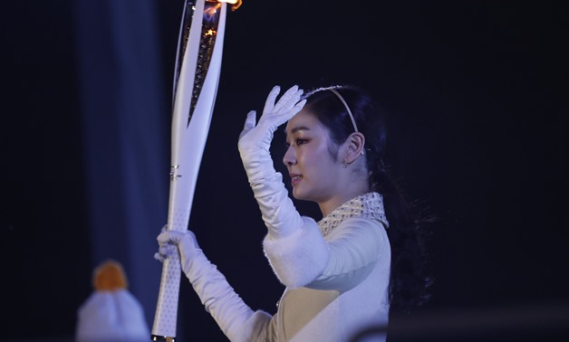 Pyeongchang 2018 Winter Olympics – Opening ceremony – Pyeongchang Olympic Stadium - Pyeongchang, South Korea – February 9, 2018 - Former figure skater Yuna Kim of South Korea prepares to light the cauldron. REUTERS/Jorge Silva