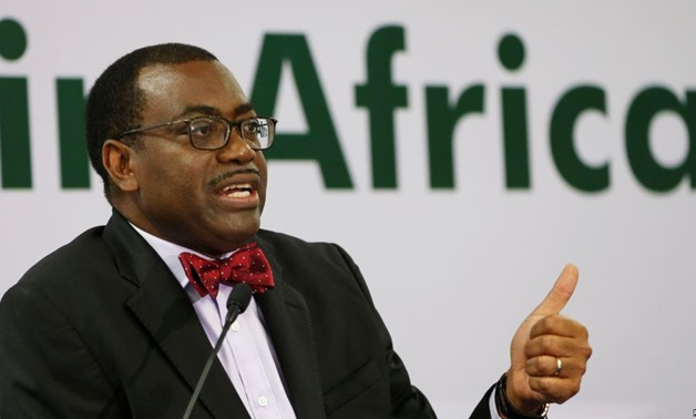 FILE - African Development Bank (AfDB) President Akinwumi Adesina gestures as he addresses a news conference at the annual meeting of AfDB in Gandhinagar, India, May 22, 2017 - Reuters