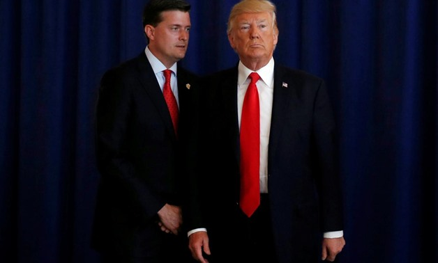 FILE PHOTO: White House Staff Secretary Rob Porter (L) reminds U.S. President Donald Trump he had a bill to sign after he departed quickly following remarks at his golf estate in Bedminster, New Jersey U.S., August 12, 2017. REUTERS/Jonathan Ernst