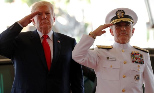 FILE PHOTO: U.S. President Donald Trump is welcomed by U.S. Navy Admiral Harry Harris, commander of United States Pacific Command, at its headquarters in Aiea, Hawaii, U.S. November 3, 2017. REUTERS/Jonathan Ernst