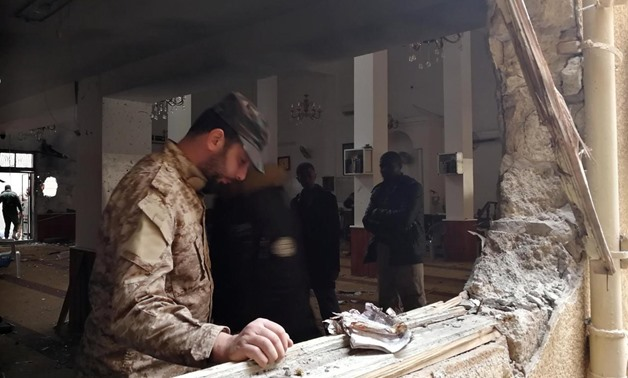 A member of the Libyan National Army inspects the damage following a twin bombing inside a mosque in Benghazi, Libya February 9, 2018. REUTERS/Stringer
