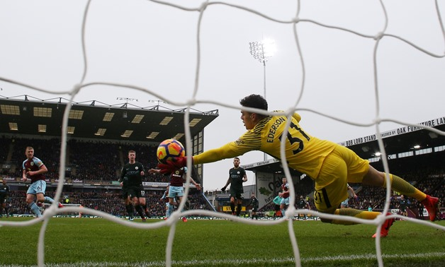 Soccer Football - Premier League - Burnley vs Manchester City - Turf Moor, Burnley, Britain - February 3, 2018 Manchester City's Ederson makes a save from Burnley's Ben Mee Action Images via Reuters/Jason Cairnduff