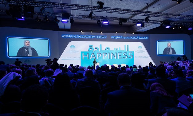 UAE's Minister of State for Happiness and Wellbeing Ohood Al-Roumi during her speech at the opening session of the Global Dialogue for Happiness in Dubai - Press Photo