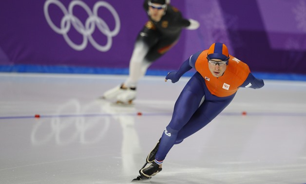 Speed Skating – Pyeongchang 2018 Winter Olympics – Men's 5000m competition finals – Gangneung Oval - Gangneung, South Korea – February 11, 2018 - Sven Kramer of the Netherlands and Patrick Beckert of Germany compete. REUTERS/Phil Noble